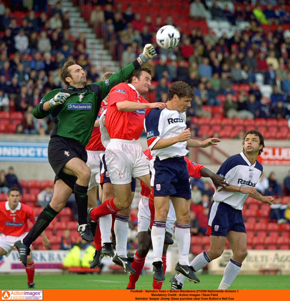 Jimmy Glass punches clear from Bolton's Neil Cox
